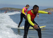 Welsh Surfing Federation Surf School specialise in teaching surfing to absolute beginners